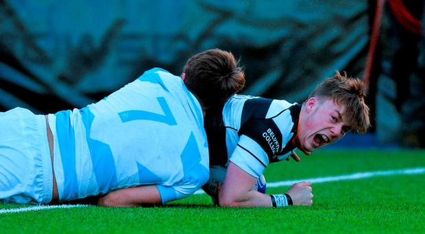 Belvedere College's David Hawkshaw scores a try despite the tackle of John Fairley, Blackrock College. Picture credit: Matt Browne / SPORTSFILE