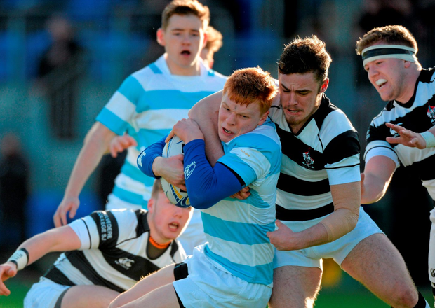 Gavin Mullin, Blackrock College, in action against Hugh Sexton, Belvedere College.