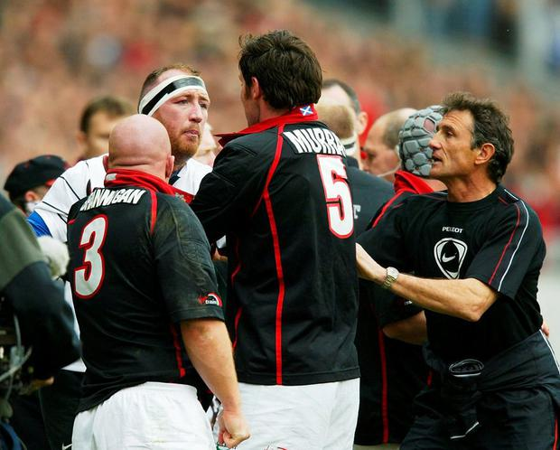 Toulouse coach Guy Noves steps in as Trevor Brennan clashes with Edinburgh's Scott Murray during a European Cup game in 2004. Photo: David Rogers/Getty Images