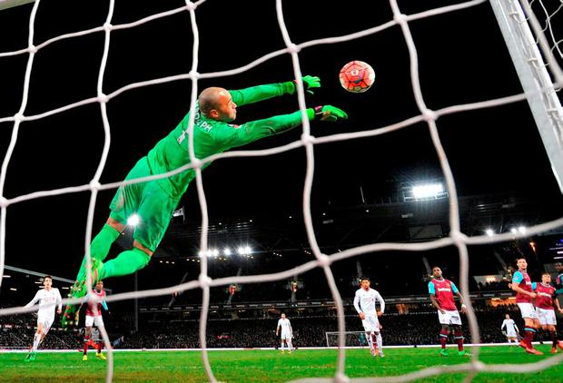 Darren Randolph makes one of his many outstanding saves against Liverpool. Photo: Glyn Kirk/AFP/Getty Images