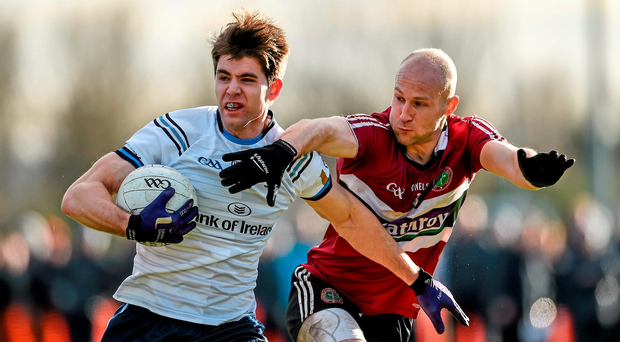 Conan Grugan (University of Ulster Jordanstown) tries to get away from St Mary's Danny McBride during the independent.ie Sigerson Cup quarter-final. Photo: Sportsfile