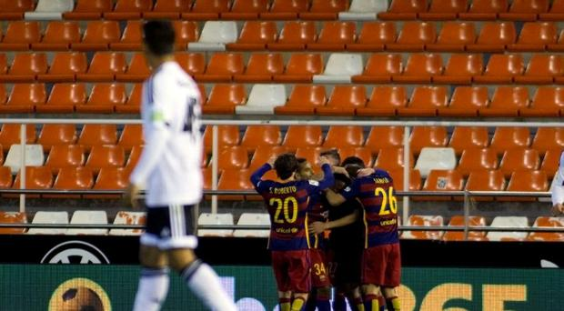 Barcelona's players celebrate after scoring during the Spanish Copa del Rey