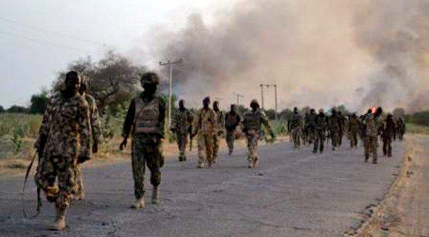 A handout photo released by the Nigerian Army on February 23, 2015 shows Nigerian troops advancing to try to recapture the town of Baga from Boko Haram.