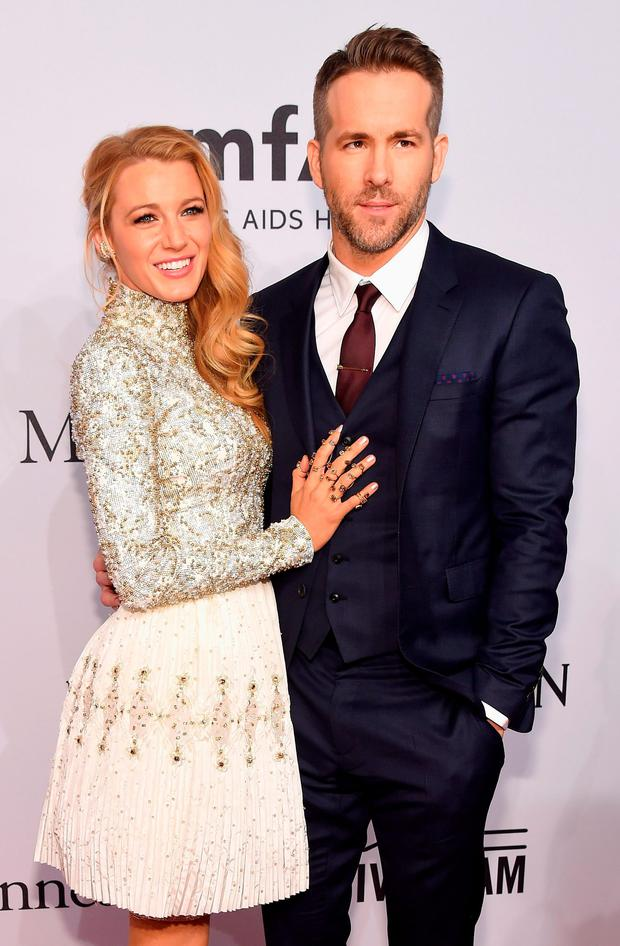 Actors Blake Lively (L) and Ryan Reynolds attend 2016 amfAR New York Gala at Cipriani Wall Street on February 10, 2016 in New York City. (Photo by Michael Loccisano/Getty Images)