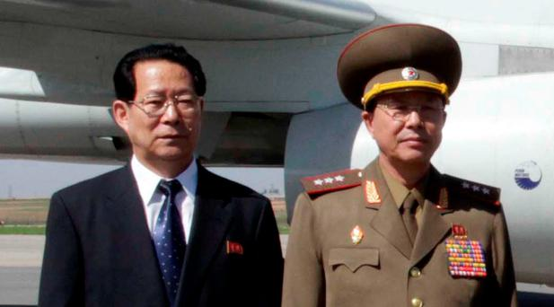 In this May 22, 2013 file photo, Kim Hyong Jun, deputy minister Foreign Affairs, Ri Yong Gil, col. gen. of the Korean People's Army, pose before leaving Pyongyang Airport in North Korea for China. (AP Photo/Kim Kwang Hyon, File)