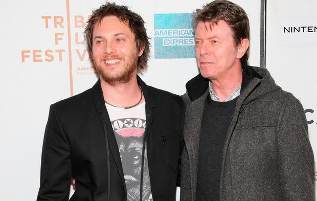 Director Duncan Jones and father David Bowie. (Photo by Michael Loccisano/Getty Images for Tribeca Film Festival)