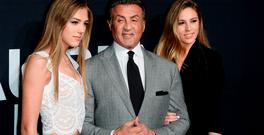 (L-R) Model Sistine Stallone, actor Sylvester Stallone, and Sophia Stallone arrive at the Saint Laurent show at the Hollywood Palladium in Los Angeles, California. (Photo by Matt Winkelmeyer/Getty Images)