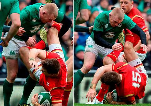 Liam Williams of Wales is dumped by Keith Earls of Ireland