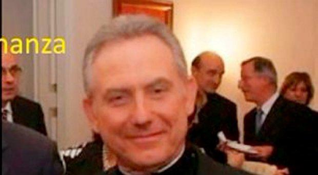This handout picture release by the Italian police (Guardia di Finanza) shows Patrizio Benvenuti, 64, a retired bishop arrested by the Italian police who accused him of stealing 30 million euros to people who believed they were investing their money in a humanitarian foundation