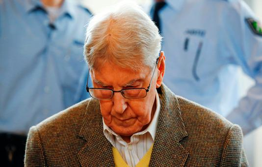 Former Auschwitz guard Reinhold Hanning arrives for his trial at the court in Detmold, western Germany Credit: Wolfgang Rattay (AFP/Getty Images)