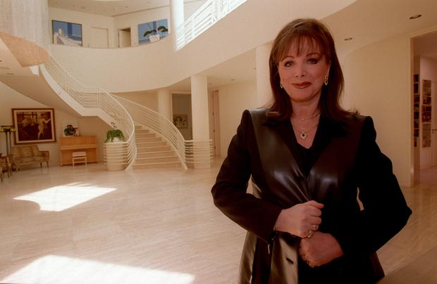 Author Jackie Collins in the entrance foyer of her Beverly Hills home, which she says she designed herself. (Photo by Iris Schneider/Los Angeles Times via Getty Images)