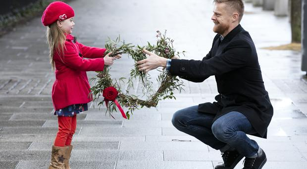 Damien Duff, footballer and patron of Heart Children Ireland, the voluntary support group for those affected by Congenital Heart Disease (CHD) is pictured with Saoirse O'Driscoll (5) from Lucan Co Dublin launching Heart Children Ireland's annual fundraiser which is taking place across the country this week - global Congenital Heart Disease Awareness Week.