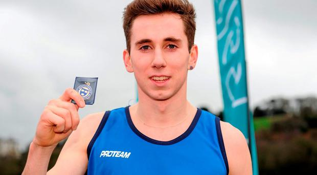 Kevin Mulcaire of St Flannans Ennis holds his winning medal following his victory in the Senior Boys event. Picture credit: Seb Daly / SPORTSFILE