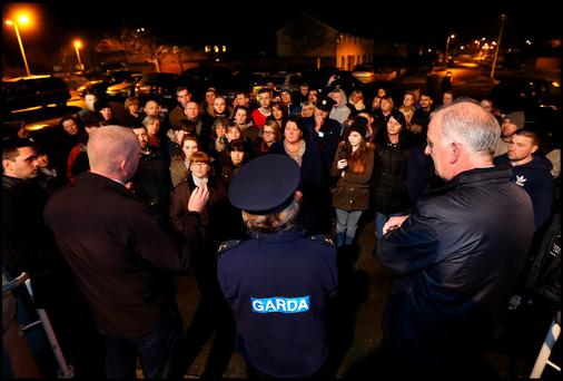 Inspector James Murphy, Sgt. Angeline Conefrey, and Sgt. James Malone speak to members of local community gather at Shanganagh Park House Community Centre car park for the meeting about a predator in the area. Photo: Steve Humphreys