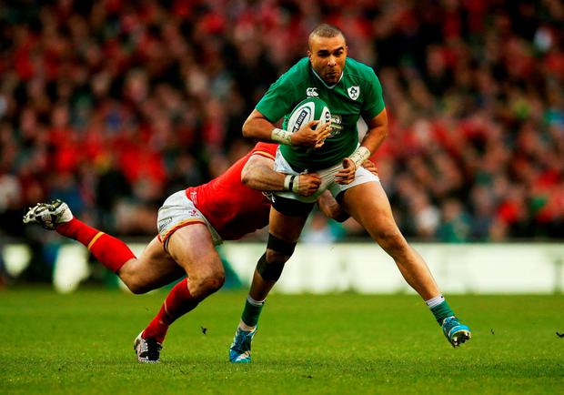 Ireland's Simon Zebo is tackled by Jamie Roberts during last Sunday's Six Nations match against Wales. Photo: Brian Lawless/PA.