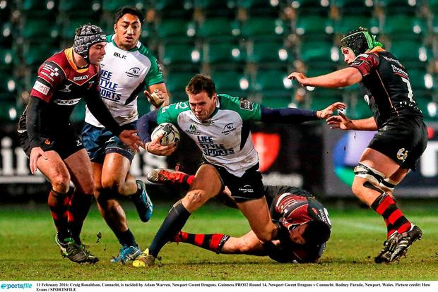 Connacht's Craig Ronaldson is tackled by Adam Warren, Newport Gwent Dragons. Picture credit: Huw Evans / SPORTSFILE