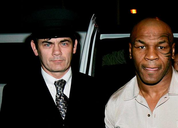 Former US heavyweight champion boxer Mike Tyson arriving with Gerry Hutch in 2006