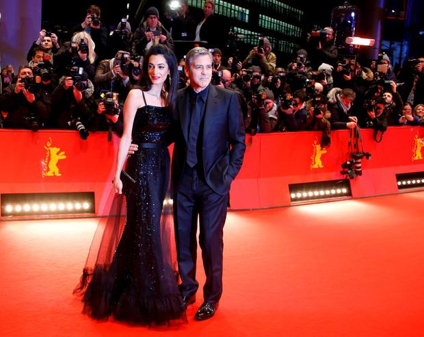 Cast member George Clooney and his wife Amal arrive on the red carpet for the screening of the movie 'Hail, Caesar!', during the opening gala of the 66th Berlinale International Film Festival, in Berlin