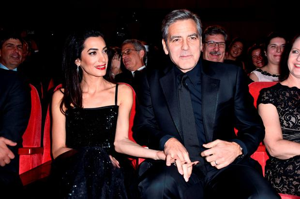 George Clooney and Amal Clooney attend the 'Hail, Caesar!' premiere during the 66th Berlinale International Film Festival Berlin at Berlinale Palace on February 11, 2016 in Berlin, Germany. (Photo by Pascal Le Segretain/Getty Images)