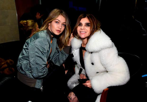 Gigi Hadid (L) and Carine Roitfeld attend Kanye West Yeezy Season 3 on February 11, 2016 in New York City. (Photo by Jamie McCarthy/Getty Images for Yeezy Season 3)