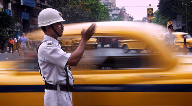 A constable traffic policeman directing taxis in India. File picture