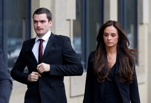 England footballer Adam Johnson, 28, arrives with partner Stacey Flounders at Bradford Crown Court, Bradford, where he will go on trial accused of sexual activity with a child