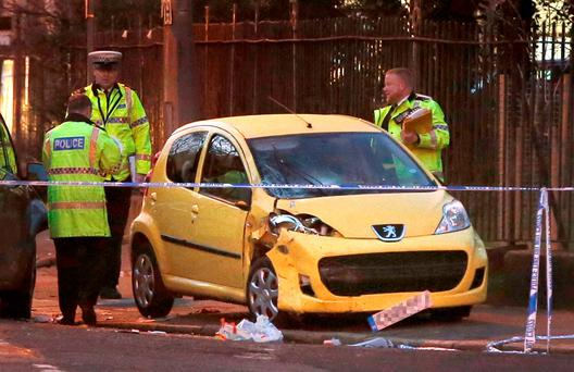 Police at the scene on Belvidere Road in South Liverpool, where five children have been hit by a car leaving a number of them with serious injuries Credit: Peter Byrne/PA Wire