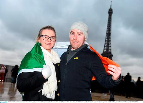 Ireland supporters Sinead Kennedy, from Ballina, Co. Mayo, and Donal Coppinger from Bantry, Co. Cork, at the Eiffel Tower in Paris