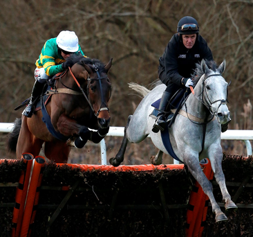 Barry Geraghty guides My Tent Or Yours (left) over a hurdle in a racecourse gallop at Kempton yesterday alongside Hargam and the now-retired Tony McCoy Photo: Getty