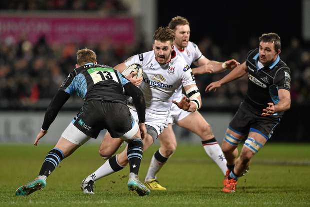 Ulster's Stuart McCloskey about to be tackled by Glenn Bryce