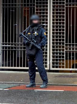 A member of the Garda Emergency Response Unit on Cork Street yesterday. Photo: Collins