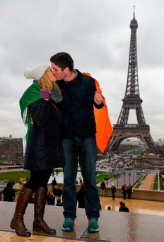 Deirdre Hennessy, from Clonakilty, Cork, and Mike O'Neill, from Aghada, Cork, at the Eiffel Tower in Paris ahead of Ireland's clash against France. Photo: Ramsey Cardy/Sportsfile