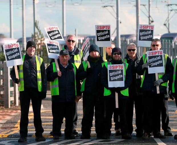 Luas drivers on a picket line in Dublin earlier this month Photo: Niall Carson/PA Wire