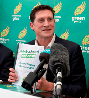 Green Party Leader Eamon Ryan holding the Green Party Manifesto at its launch. Photo: Photocall / RollingNews.ie