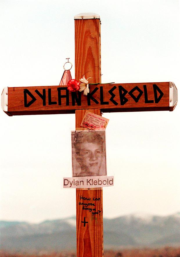 FILE - This April 28, 1999 file photo shows a cross bearing the name and likeness of Dylan Klebold and a message