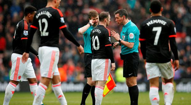 Manchester United's Wayne Rooney talks to referee Andre Marriner at the end of the match