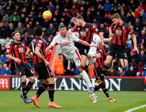 AFC Bournemouth's Simon Francis (right), Steve Cook (second right) and Stoke City's Jonathan Walters (centre) battle for the ball