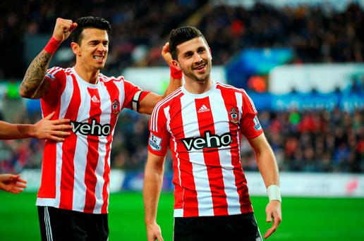 Shane Long (R) of Southampton celebrates scoring his team's winner with his team mate Jose Fonte (L) during the Barclays Premier League match between Swansea City and Southampton at the Liberty Stadium