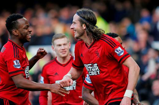 Jonas Olsson and Stephane Sessegnon celebrates after Salomon Rondon scored the first goal for West Brom Reuters / Andrew Yates