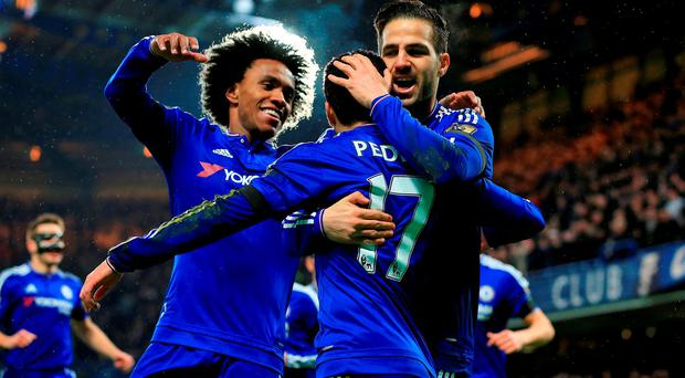 Chelsea's Pedro celebrates scoring his side's second goal with his team-mates during the Barclays Premier League match at Stamford Bridge