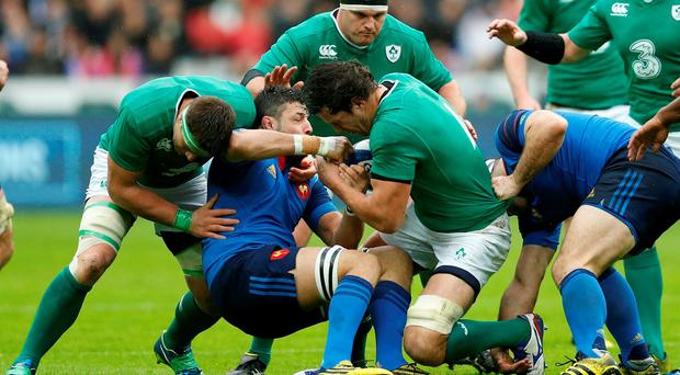 Frances Damien Chouly in action with Ireland's Mike McCarthy