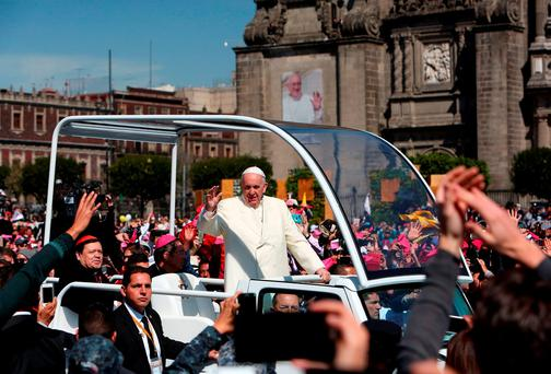 Pope Francis waves to the crowd from the popemobile in Zocalo Square in Mexico City, February 13, 2016. REUTERS/Ginnette Riquelme