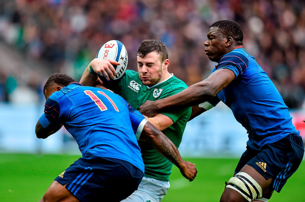 Robbie Henshaw, Ireland, is tackled by Virimi Vakatawa, left, and Yacouba Camara of France. Photo: Sportsfile