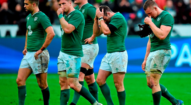 Dejected Ireland players, from left, Conor Murray, Jamie Heaslip, Donnacha Ryan, Fergus McFadden and Tommy O'Donnell, after the game. Photo: Sportsfile