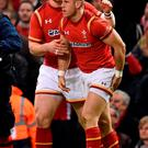 Wales' Gareth Davies (right) celebrates his try with George North. Photo: PA