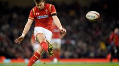 Dan Biggar of Wales kicks a conversion. Photo: Reuters