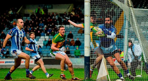 Ballyboden 'keeper Paul Durcan is judged to have kept the ball in play, despite an appeal from Michael Quinlivan of Clonmel Commercials that he had carried it over the line. Photo: Piaras Ó Mídheach