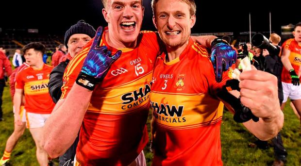 Castlebar Mitchel's Danny Kirby and Alan Feeney celebrate their side's victory. Photo: Stephen McCarthy / Sportsfile