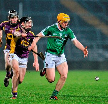 Limerick's Paul Browne in action against Wexford's Lee Chin. Photo: Sam Barnes / Sportsfile