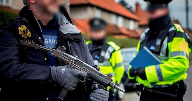 ARMED GARDAI ON THE STREETS: Gardai on checkpoints in Crumlin yesterday. Photo: Mark Condren